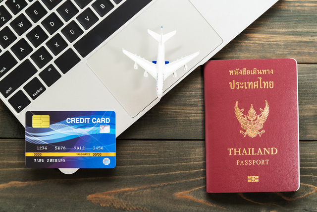 Passport with  credit card on laptop